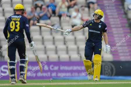 Jimmy Adams of Hampshire raises his bat on reaching a half century during the Royal London One Day Cup match between Hampshire County Cricket Club and Essex County Cricket Club at the Ageas Bowl, Southampton. Picture by Dave Vokes