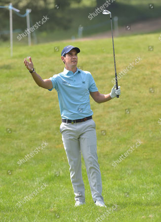Stock Image of Matteo Manassero of Italy plays his 2nd shot on the 11th.