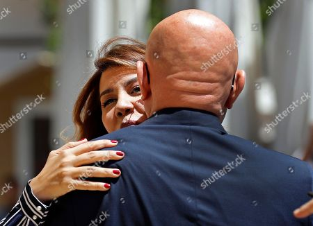 Stock Picture of Paula Yacoubian, a Lebanese journalist and independent lawmaker, kisses the former Lebanese Prime Minister Tammam Salam, as they arrive to parliament to attend a session to elect the house speaker, in Beirut, Lebanon, . Lebanese lawmakers have overwhelmingly re-elected the longtime octogenarian parliament speaker, Nabih Berri, to the post, giving him monopoly of the office for 30 years