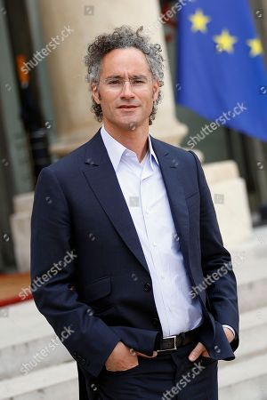 """Alexander Karp, US co-founder and CEO of the software firm Palantir Technologies leaves after the """"Tech for Good"""" Summit at the Elysee Palace in Paris, . French President Emmanuel Macron seeks to persuade Facebook CEO Mark Zuckerberg and other internet giants to discuss tax and data protection issues at a Paris meeting set to focus on how they could use their global influence for the public good"""