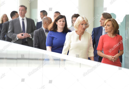 Camilla Duchess of Cornwall speaks with journalist Sian Williams (R) as she visits the headquarters of Independent Television News Ltd (ITN) to mark the 21st anniversary of 5 News