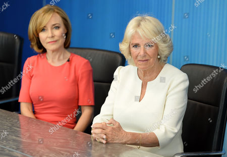 Camilla Duchess of Cornwall speaks members of the 5 News team, including journalist Sian Williams (L) as she visits the headquarters of Independent Television News Ltd (ITN) to mark the 21st anniversary of 5 News