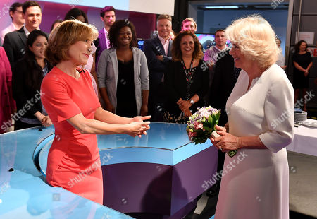 Camilla Duchess of Cornwall speaks with journalist Sian Williams as she visits the headquarters of Independent Television News Ltd (ITN) to mark the 21st anniversary of 5 News