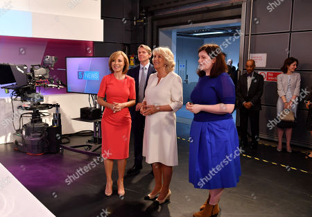 Camilla Duchess of Cornwall with journalist Sian Williams (L) as she visits the headquarters of Independent Television News Ltd (ITN) to mark the 21st anniversary of 5 News