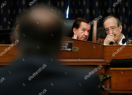 Stock Picture of Mike Pompeo, Eliot Engel, Ed Royce. Chairman Rep. Ed Royce, R-Calif., center, talks with Ranking Member Rep.Eliot Engel, D-NY., right, as they listen to testimony by Secretary of State Mike Pompeo, left, at the House Foreign Affairs Committee hearing on Capitol Hill in Washington