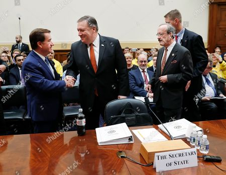 Stock Image of Mike Pompeo, Eliot Engel, Ed Royce. Secretary of State Mike Pompeo, center, is greeted by Chairman Rep. Ed Royce, R-Calif., left, and Ranking Member Rep.Eliot Engel, D-NY., right, before testifying at the House Foreign Affairs Committee hearing on Capitol Hill in Washington