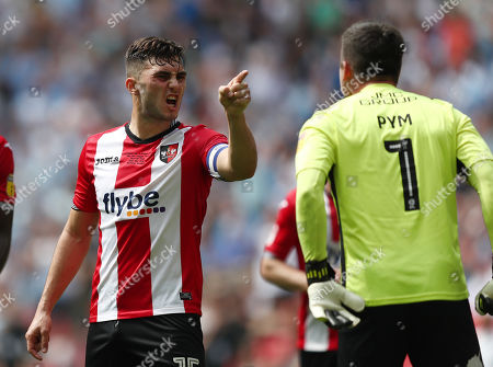 Tempers flare between Jordan Moore-Taylor of Exeter City and Christy Pym of Exeter City