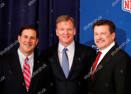 Arizona Gov. Doug Ducey, left, poses with NFL commissioner Roger Goodell, center, and Arizona Cardinals owner Michael Bidwill after a news conference where Goodell announce Phoenix will host the Super Bowl in 2023 during the NFL owner's spring meeting, in Atlanta
