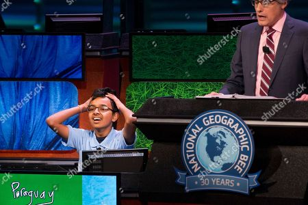 Venkat Ranjan, of San Ramon, Calif. reacts as host Mo Rocca tells him he has won the 30th National Geographic Bee Championship final round at the National Geographic Society in Washington