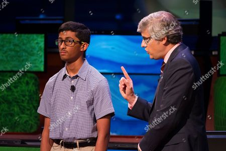 Host Mo Rocca asks a question of finalist Vishal Sareddy during the 30th National Geographic Bee Championship final round at the National Geographic Society in Washington