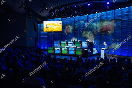Host Mo Rocca asks a question of contestants during the 30th National Geographic Bee Championship final round at the National Geographic Society in Washington