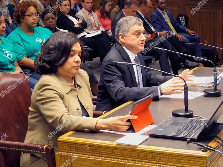 Commissioner of Administration Jay Dardenne, the governor's chief budget adviser, right, speaks to the House Ways and Means Committee, in Baton Rouge, La. Revenue Secretary Kimberly Robinson sits with him