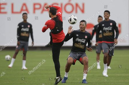 Anderson Santa Maria, Jose Carvallo. Anderson Santa Maria, center right, fights the ball with Jose Carvallo during the national soccer team's training in Lima, Peru, . Peru is getting ready for the upcoming World Cup in Russia