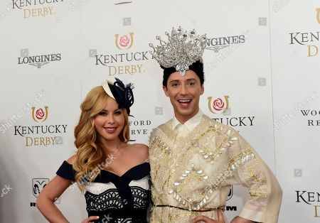 Tara Lipinski, Johnny Weir. Tara Lipinski and Johnny Weir, American Olympic figure skaters and TV commentators, walk the Kentucky Derby red carpet, at Churchill Downs in Louisville, Ky. Longines, the Swiss watch manufacturer known for its luxury timepieces, is the Official Watch and Timekeeper of the 144th annual Kentucky Derby