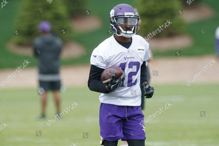 Stock Photo of Minnesota Vikings wide receiver Tavarres King works out during practice at the NFL football team's training camp, In Eagan, Minn