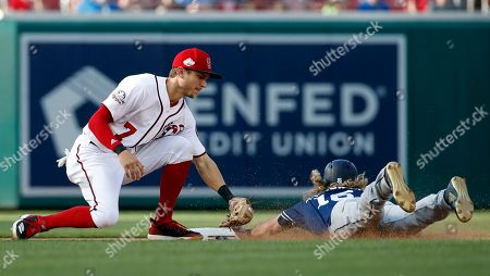 Trea Turner, Travis Jankowski. Washington Nationals shortstop Trea Turner tags out San Diego' Travis Jankowski on the steal attempt during the eighth inning of a baseball game at Nationals Park, in Washington. The Padres won 3-1