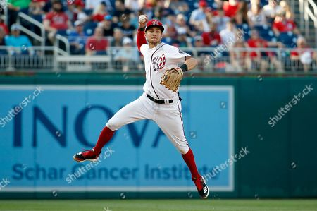 Washington Nationals shortstop Trea Turner makes a throw to first base but San Diego Padres' Travis Jankowski is safe, during the eighth inning of a baseball game at Nationals Park, in Washington. The Padres won 3-1