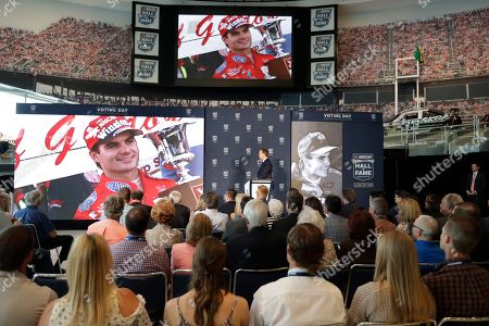Stock Photo of Brian France, Jeff Gordon. NASCAR chairman Brian France, center, watches a video of driver Jeff Gordon after after announcing Gordon will be inducted into the 2019 class of the NASCAR Hall of Fame during an announcement in Charlotte, N.C