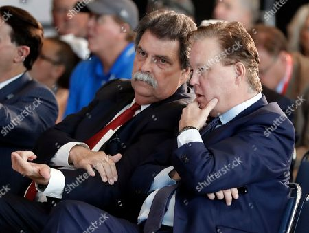 Stock Image of Brian France, Mike Helton. NASCAR Chairman Brian France, right, talks with Vice Chairman Mike Helton before an announcement of the 2019 class of the NASCAR Hall of Fame in Charlotte, N.C