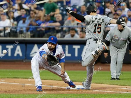 Adrian Gonzalez, Brian Anderson. Miami Marlins' Brian Anderson (15) beats the throw to first base for a single as New York Mets' Adrian Gonzalez waits for the ball during the third inning of a baseball game, in New York