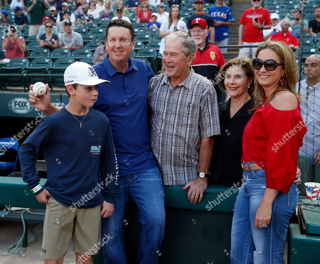 George W. Bush and Laura Bush meet PGA golfer JJ. Henry, second from left, his son Connor Henry, 13, and wife Lee Henry, right, prior to of a baseball game between the Texas Rangers and New York Yankees, in Arlington, Texas