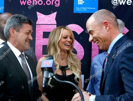 Stock Photo of West Hollywood Mayor John Duran, left, Stormy Daniels, center, and attorney Michael Avenatti attend a ceremony for Daniels receiving a City Proclamation and Key to the City on in West Hollywood, Calif