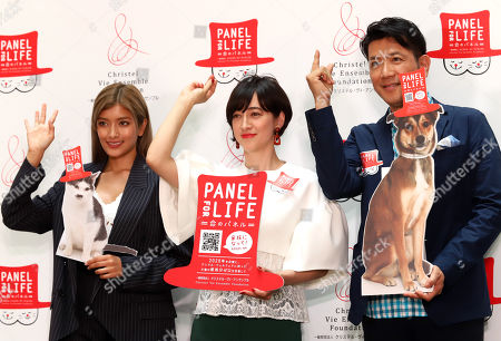 """Japan's TV personality Christel Takigawa (C), model Rola (L) and actor Tetsuya Bessho (R) announce Takigawa's animal welfare group """"Christel Vie Essemble Foundation"""" will start the new project """"Panel for Life"""" to reduce euthanasia of dogs and cats in Tokyo on Tuesday, May 22, 2018."""