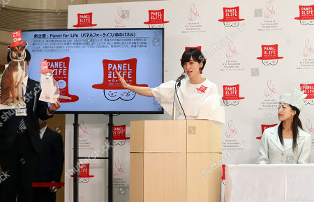 """Japan's TV personality Christel Takigawa (C) announces her animal welfare group """"Christel Vie Essemble Foundation"""" will start the new project """"Panel for Life"""" to reduce euthanasia of dogs and cats in Tokyo on Tuesday, May 22, 2018. Japan's Princess Tsuguko of Takamado (R) also attended the event."""