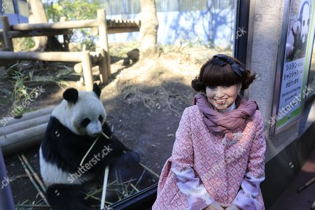 Tetsuko Kuroyanagi, actress and honorary chairwoman of the Panda Protection Institute of Japan, poses for photographs beside a female giant panda Shin Shin at Ueno Zoo in Tokyo, Japan.