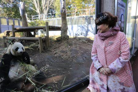 Tetsuko Kuroyanagi, actress and honorary chairwoman of the Panda Protection Institute of Japan, looks at a female giant panda Shin Shin at Ueno Zoo in Tokyo, Japan.