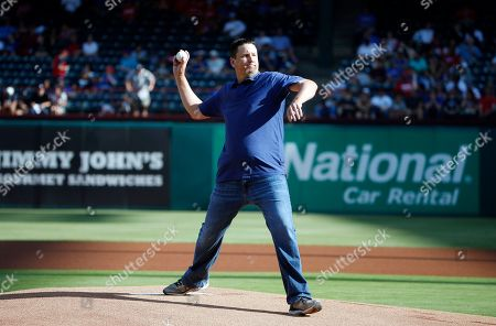 PGA golfer JJ Henry throws out the first pitch a baseball game between the New York Yankees and Texas Rangers, in Arlington, Texas