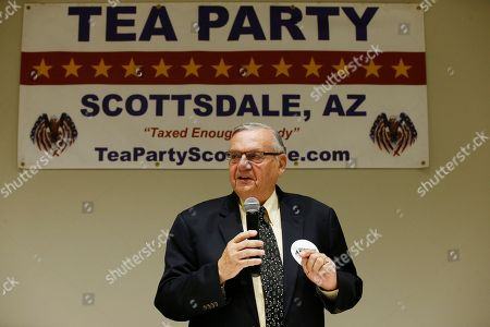 Republican Senate candidate and former Maricopa Country Sheriff Joe Arpaio talks about his platform policies at a Scottsdale Tea Party event in Scottsdale, Ariz. Arizona conservatives are torn between two icons of their movement - Arpaio and former state senator Kelli Ward - in the GOP Senate primary