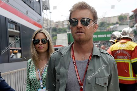 Former Formula One driver Nico Rosberg and his wife Vivian Sibold walk in the pit lane during the first practice session for the Monaco Formula One Grand Prix at the Monaco racetrack, in Monaco, . The Monaco Grand Prix will be held on Sunday, May 27