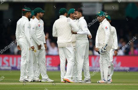 Pakistan's Faheem Ashraf, second right, celebrates with teammates after taking the wicket of England's Jonathan Bairstow during the first day of play of the first test cricket match between England and Pakistan at Lord's cricket ground in London
