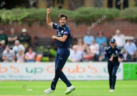 Steve Finn celebrates the wicket of Steve Davies of Somerset