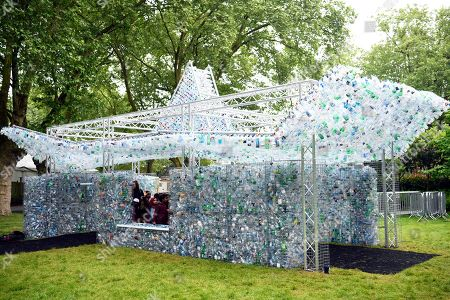 Stock Image of A view on a sculpture 'Waste of Space' by British artist Nick Wood at London Zoo in London, Britain, 24 May 2018. Waste of Space is an installation made from 15,000 discarded single use bottles collected from London's waterways. The sculpture represents the amount of single use bottle that are purchased every minute in Britain.