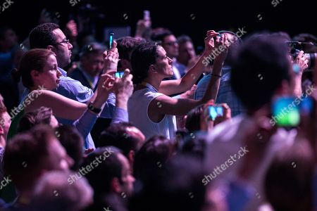 People take pictures of Facebook CEO Mark Zuckerberg as he arrives on stage during the VivaTech fair in Paris, France, 24 May 2018.  The annual commercial convention runs from the 24 to 26 May.