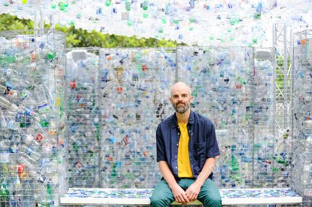 "Architect Nick Wood poses at the unveiling of an art installation called ""Space of Waste"", in ZSL London Zoo."