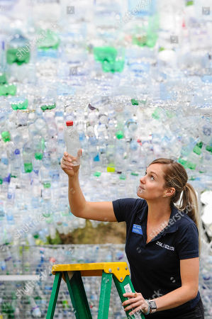 "Fiona Llewellyn, ZSL's Marine Project manager, places the final bottle at the unveiling of an art installation called ""Space of Waste"" by architect Nick Wood, in ZSL London Zoo."