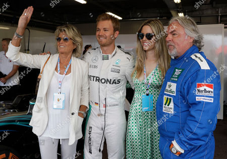 From right, former Formula One driver Keke Rosberg, is flanked by Vivian Sibold wife of his son world champion Nico, second form left, and Sina Rosberg, after a parade exhibition at the and of the first free practice at the Monaco racetrack, in Monaco, . The Formula one race will be held on Sunday