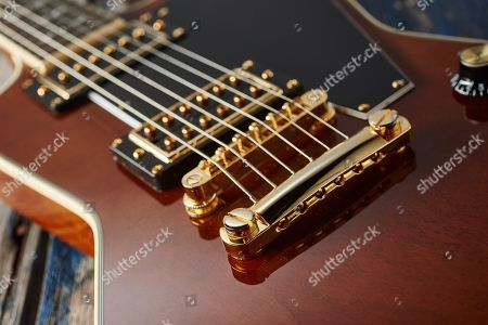 Detail Of The Gold Locktone Tune-o-matic Bridge And Stopbar On An Epiphone Ltd Edition Lee Malia Explorer Custom Artisan Outfit Electric Guitar