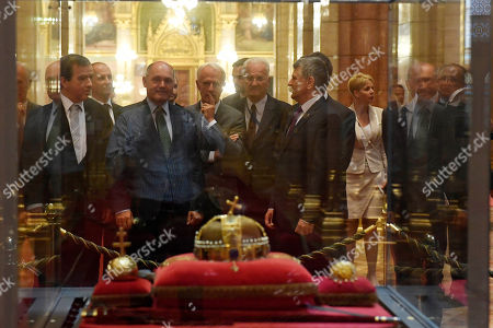 President of the Austrian National Council, the first chamber of the country's Parliament Wolfgang Sobotka (2-L) is shown the Holy Crown of Hungary by Speaker of the Hungarian Parliament Laszlo Kover (R) during their meeting in the Parliament building in Budapest, Hungary, 24 May 2018.