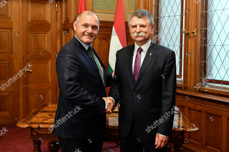 President of the Austrian National Council, the first chamber of the country's Parliament Wolfgang Sobotka (L) shakes hands with the Speaker of the Hungarian Parliament Laszlo Kover (R) before their talks in the Parliament building in Budapest, Hungary, 24 May 2018.