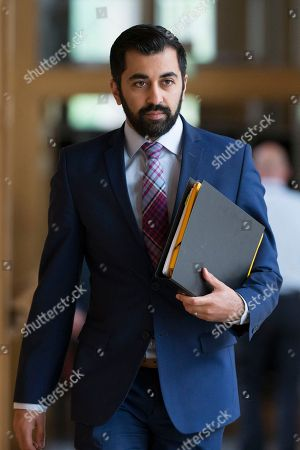 Scottish Parliament First Minister's Questions - Humza Yousaf, Minister for Transport and the Islands makes his way to the Debating Chamber.