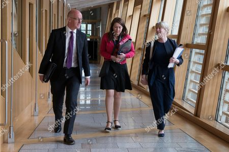 Scottish Parliament First Minister's Questions - John Swinney, Deputy First Minister and Cabinet Secretary for Education and Skills, Aileen Campbell, Minister for Public Health and Sport, and Shona Robison,Cabinet Secretary for Health, Wellbeing and Sport, make their way to the Debating Chamber.