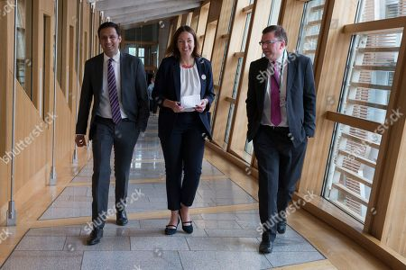 Scottish Parliament First Minister's Questions - Anas Sarwar, Kezia Dugdale and Colin Smyth make their way to the Debating Chamber.