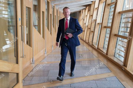 Stock Image of Scottish Parliament First Minister's Questions - Tavish Scott makes his way to the Debating Chamber.