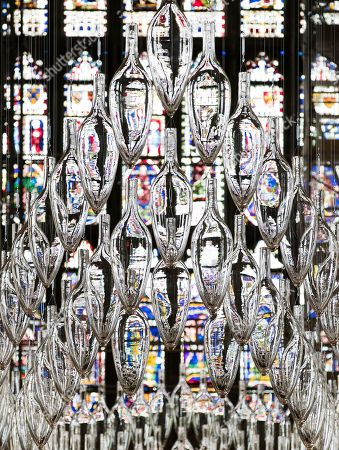A sculpture entitled 'Boat of Remembrance, 2018' - a 20-metre installation of 100 glass amphorae - is suspended in the shape of a ship high above the Nave of Canterbury Cathedral. A series of glass installations by artists Philip Baldwin and Monica Guggisberg reflecting on themes of war and remembrance, migration and refugees are going on display at the cathedral commemorating the 100th anniversary of the end of the First World War.