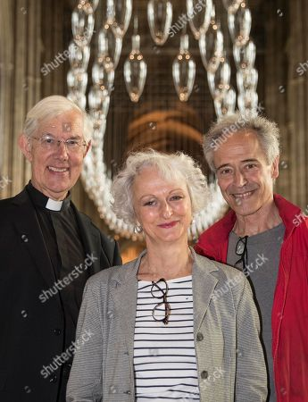 Artists artists Philip Baldwin (R) and Monica Guggisberg stand with Very Revd Dr Robert Willis at Canterbury Cathedral. A series of glass installations by the artists reflecting on themes of war and remembrance, migration and refugees are going on display at the cathedral commemorating the 100th anniversary of the end of the First World War.