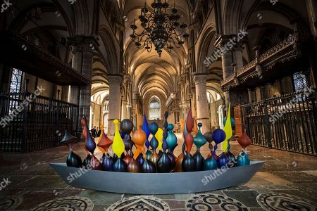 Baldwin & Guggisberg's glass and steel sculpture 'Pilgrim's Boat, 2018' is displayed in Trinity Chapel at Canterbury Cathedral. A series of glass installations by artists Philip Baldwin and Monica Guggisberg reflecting on themes of war and remembrance, migration and refugees are going on display at the cathedral commemorating the 100th anniversary of the end of the First World War.